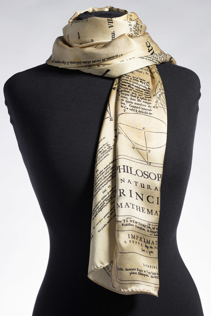 The Isaac Newton Scarf by Howard Guest. Images from Isaac Newton's copy of the Principia printed on 100% silk and Made in Britain.